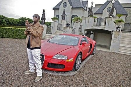 Birdman with his custom red Bugatti
