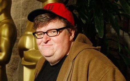 Michael Moore denies being part of the 1%, but owns a $2 million vacation home.