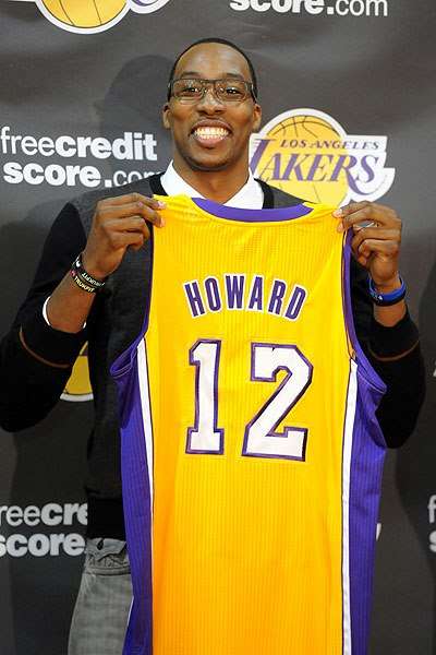 Dwight Howard holds up Lakers jersey