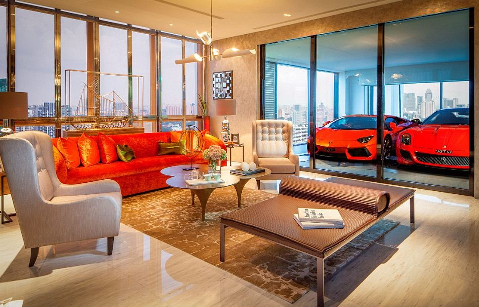 Rich people in singapore park their ferraris in the living for Garage family room