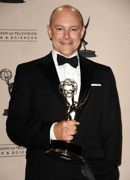 Rob Corddry Holding an Emmy