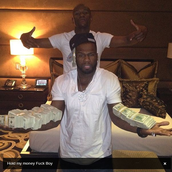 50 Cent holding Floyd Mayweather's money