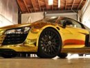 "Tyga's Car:  Nothing Says ""Successful Rap Career"" Like a Gold Chrome Car"