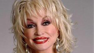 Thumbnail for Dolly Parton Will Make Millions Off Whitney Houston's Death