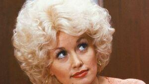 Thumbnail for Dolly Parton: Big Hair, Big Voice, Big Shoes... Ginormous Bank Account.