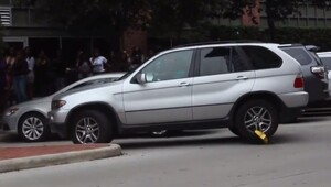 Thumbnail for Woman In A BMW SUV Gets Rid Of Parking Boot In A Very Creative Way